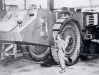 Dwarfed by its 8.5 feet high track-wheels, this US 9th Army Sergeant is examining a partly-made new German super-tank