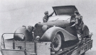 Goering\'s Car, Captured by British Troops, Being Loaded onto a Trailer Ready for Conveyance to REME Workshops