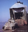 M4A1 Sherman landing from an LST (Landing Ship Tank)