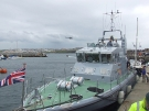 P292 HMS Charger (Archer Class Navy Patrol Vessel) with Royal navy Lynx Helicopter in the Background